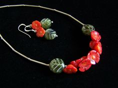 Carved Coral flowers and Vessonite leaf necklace and earrings set in Sterling…