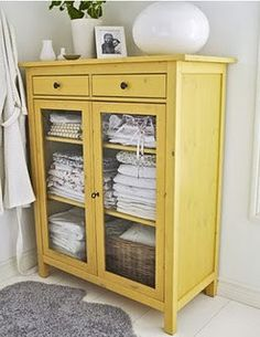 Very similar to the upcycled cabinet for the guest room// Ikea Hemnes linen closet repainted shabby yellow.