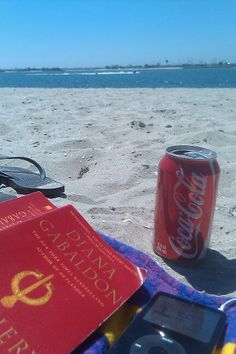 reading at the beach with a delicious coke - make it a Diet Coke and I am so happy!