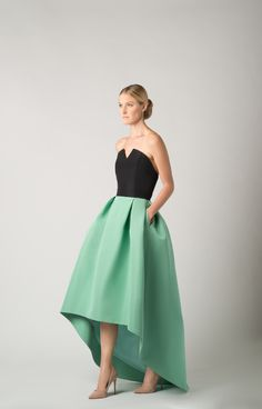 Silk faille Strapless neckline with V detailing Fitted bodice with boning for support Seam at natural waist Pleated full skirt with high-low hem Side slit pockets Concealed back zipper…