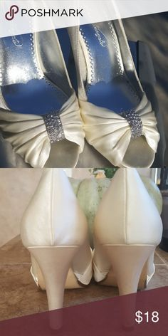 Bridal shoes Ivory bridal shoes. The brand is Michaelangelo. I wore them once in a bridal show. Shoes Heels