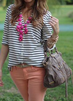 Navy and white striped top with coral pants.