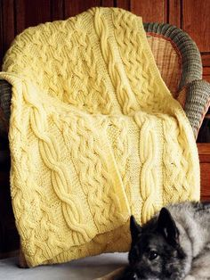 Reversible Cabled Afghan Knitting Pattern - This knitting pattern is unique for cabled afghans because it's reversible! It looks just as great on either side!  Finished size: 48″ x 58″.