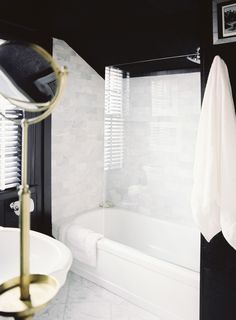 Black walls against the gorgeous white marble tile of the shower