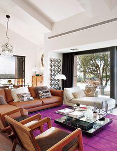 Portugal mod summer home, Nuno Benito, contemporary living room, leather sofa, fur hide suzani pillows, magenta rug