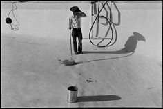 Alex Webb  USA. West Texas. 1975. Mexican Cleaning Swimming Pool. Illegal worker.