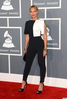 I'm torn. I want to not like it, but I love it. She looks amazing, but her hair could have been better. #PantSuitMEOW