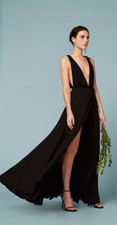 Cringe-Free Bridesmaid Dress Ideas: Classic Black Long Reformation Dress With a Leg Slits  // See 8 more Options: (http://la.racked.com/2016/1/20/10786400/bridesmaid-dresses-wedding-los-angeles-designers#6256855)