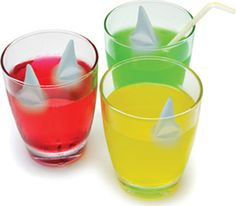 The Shark Bite-Ahead of your pirate birthday party, make some ice cubes out of cranberry juice and freeze a gummi shark into each one. Then serve a clear drink at the party such as Sprite, but add a few of the ice cubes to each glass when serving. Add 'Beware of the Shark' labels to each glass then sit back and wait. As the ice cubes melt the Sprite will start to turn blood red and the gummi sharks will float to the top.