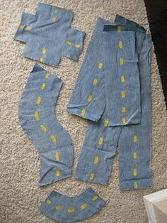 Portable roads that are easy for kids to put together and will travel easily, made out of old denim and yellow paint. velcro helps them stick to carpet.  Awesome idea