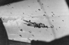 A B-17 bomber of the 452nd Bomber Air Group dodges flak during flight over Ludwigshafen, Germany.