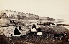 """""""Francis Frith, 'Hastings from the beach – low water', The Gossiping Photographer at Hastings, 1864 Governesses watch their young charges while men in shirt-sleeves laze in this photograph of a Victorian vacation to the seaside. Antique Photos, Old Photos, Vintage Photos, Hastings Seafront, Seaside Holidays, Beach Holiday, British Seaside, Victorian Life, British Library"""