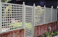 Garden Trellis Company. Trellis and gate approx 6' high.