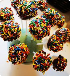 "Marshmallow Pops!  What a cute and simple alternative to the ""cake pop"".  Place a marshmallow on the end of a lollipop stick, dip in melted chocolate first, then dip in sprinkles.  Easy and Yummy <3"