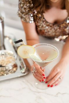 French Pear Cocktail: St. Germain, Pear Vodka, Champagne and a sugar rim garnished with pear rings.