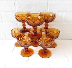 Vintage Gold Thumbprint Glasses  Set of 8   Measures 4 1/4 inches in height, and 3 3/8 inches in dia