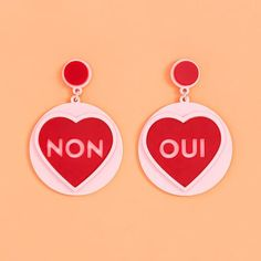 STYLE: oui non you're hot then you're cold, you're oui then you're non...now you can answer 'yes' and 'no' questions just by turning your head from side to side. these earrings by jennifer loiselle ar