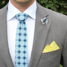 Great combination of tie, suit and pocket square. Love the pop of yellow.