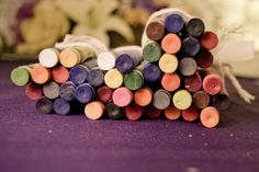 Crayons on the tables at a wedding for kids to color.