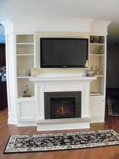 Built ins and an electric fireplace. Nice if TV rotated between rooms