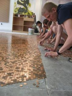 Floor made out of pennies! Just think of what other things you could make with this idea