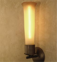 "Atlantis Sconce  18"" High x 4"" Diameter x 5"" Projection One candelabra sized bulb.  WATTAGE??  OTHER FINISHES??"