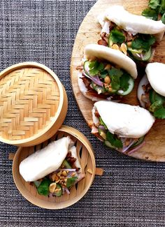 Braised pork belly bao with pickled cucumber and crumbled peanuts