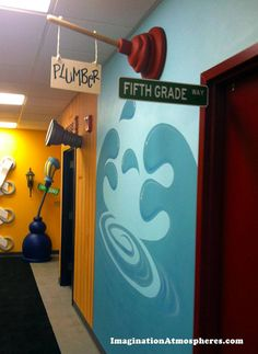 Creative directional signage in a children's ministry hallway/