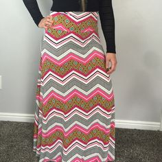 """Chevron Print Maxi This lightweight fabric features chevron, stripes and other fun prints in black, white, bright pink, green, orange and yellow. Wear it as a maxi skirt or even as a strapless beach dress or coverup. 42"""" waist to hem. 13"""" waist laying flat. Super stretchy and so comfortable! Check my closet for other colors and sizes. Bundle to save! Mimx Skirts Maxi"""