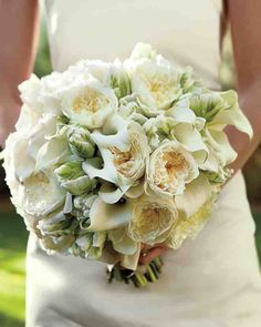 "The bride's bouquet combined garden roses, calla lilies, and parrot tulips. ""I wanted to keep most things white during the ceremony and then add color at the reception,"" Amy says."