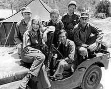 The cast of M*A*S*H from Season 2, 1974 (clockwise from left): Loretta Swit, Larry Linville, Wayne Rogers, Gary Burghoff, McLean Stevenson, and Alan Alda)