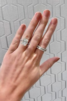 This 6.00 carat radiant shape diamond center stone engagement ring is paired with a stunning 8.17 carat diamond eternity band #radiant #diamond #6carat #carat #anniversaryband #eternityband #band #ring