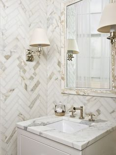 Square sink, chevron patterned tile, sconces...