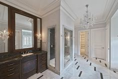 A groin vaulted ceiling adds opulence to the magnificent glass-encased shower which also features a steamer.