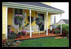 Country Porch | Flickr - Photo Sharing! I may have pinned this before, but I love the yellow with the flowers and table.