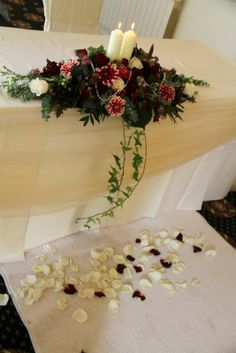 On the Registrars table a lovely candlelit traditional design with a sprinkling of fresh Rose petals on the floor in front for our Bride & Groom to stand on