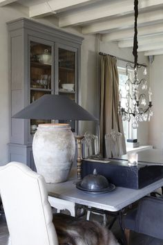 Belgian Interior /Martine Haddouche/. Would like a huge lamp like this from a shop in Florence yeah!