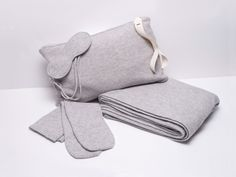 """""""Le Kaska—a French heritage brand (founded in 1918) that recently came back to life—makes the ultimate cashmere travel set: a blanket/shawl, sleep mask, and long socks, with a pouch that doubles as a pillow. The small company works with the highest grade of Mongolian cashmere (Coco Chanel used it for her first suit collection), and you feel it."""" —Editorial Assistant Chantel Tattoli Le Kasha Travel Set, $1,050"""