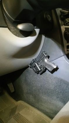 Installed this gun holster in my car for my Springfield handguns. Modified the magazine loader and the holster that came with the gun.