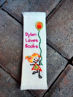 Customized / Personalized handmade cross stitch bookmark for kids, it is great for birthday, baby shower, goodie bag, boy and girl. $6.99, via Etsy.