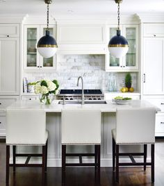 like the classic white kitchen with mixed metallic. Not sure about the lights though.