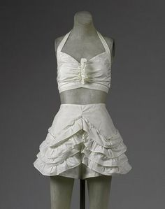 A ruffled skirted panty and halter top. This photo is from the Met Museum archive. Truly lovely.