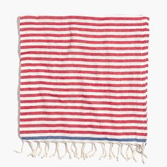 """Nashville-based entrepreneur Sue Joyce is such a fan of traditional Turkish hammam towels that she went directly to the source, employing the artisan families who have hand-loomed them for generations (their expertise is evident in the lightning-quick way they hand twist the fringe). Woven in her favorite bright colors and stripes, these incredibly absorbent beach towels are light enough to wear as a scarf or a sarong. <ul><li>Cotton.</li><li>72""""H x 37""""W.</li><li>Import.</li></ul>"""
