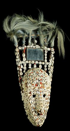 Africa | Ntomo mask from the Bamana people of Mali | Wood, cowrie shells, seeds, fur, mirror