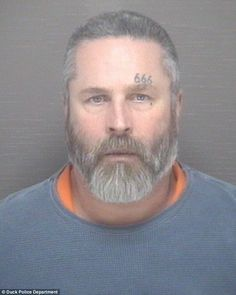 Charged: William Long, 53 (photographed) has been charged with first-degree murder for stabbing a homeless man in a church, the man sports a '666' tattoo above his left eyebrow