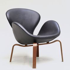Swan Chair, Arne Jacobsen.  I love it with the plywood legs, but would prefer chartreuse or aqua or orange upholstery