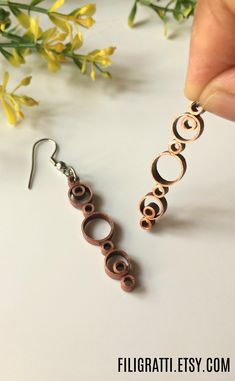 Simple dangle earrings with a unique & elegant design. These pretty earrings have a metallic finish but without the heaviness. #DangleEarrings, #LightweightEarrings, #QuillingEarrings, #CopperEarrings, #SimpleEarrings