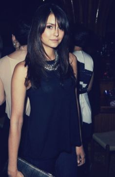 The gorgeous Nina Dobrev...really into the way she's been wearing her hair lately.