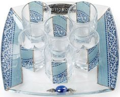 Glass Kiddush Cup Set with Blue and White Decor by World of Judaica. $34.00. Your order includes 1 item(s).. You will be pleasantly surprised! The vast majority of our shipments arrive within 10-14 business days from time of shipment, far in advance of Amazon's default calculation of shipping times for items shipped from Israel.. Dimensions: 19. The ideal way to share your Kiddush wine with your family and guests, this beautifully handcrafted glass Kiddush cup set would be ...