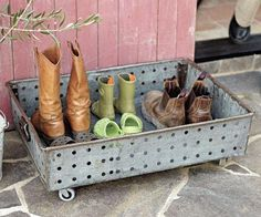Re-purpose an old galvanized tray as a boot box next to the front door.  Just add wheels and you are good to go.......D.